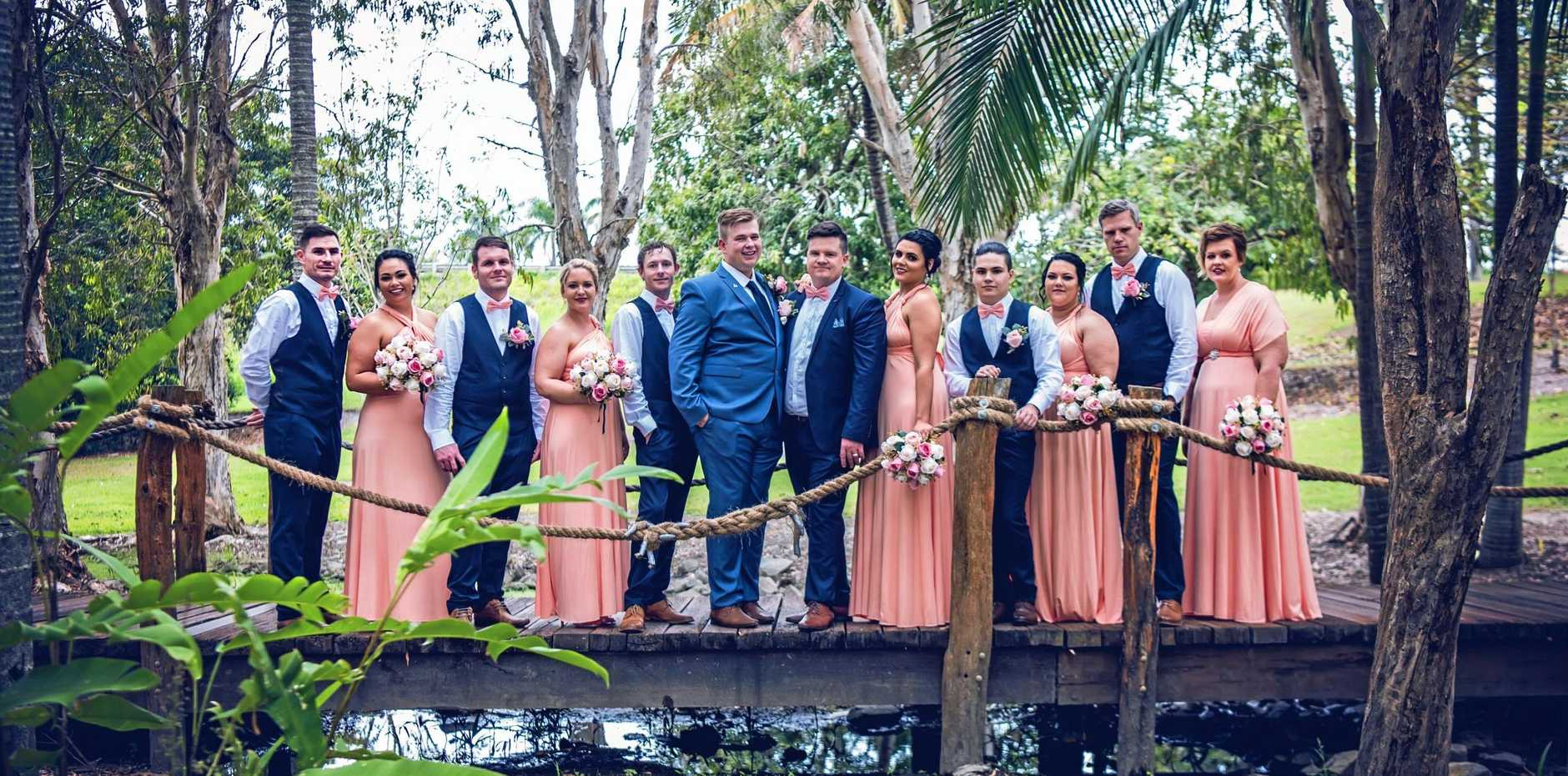 JUST MARRIED: Michael Lewis and Tyson Limpus with their wedding party after their July 7 marriage.