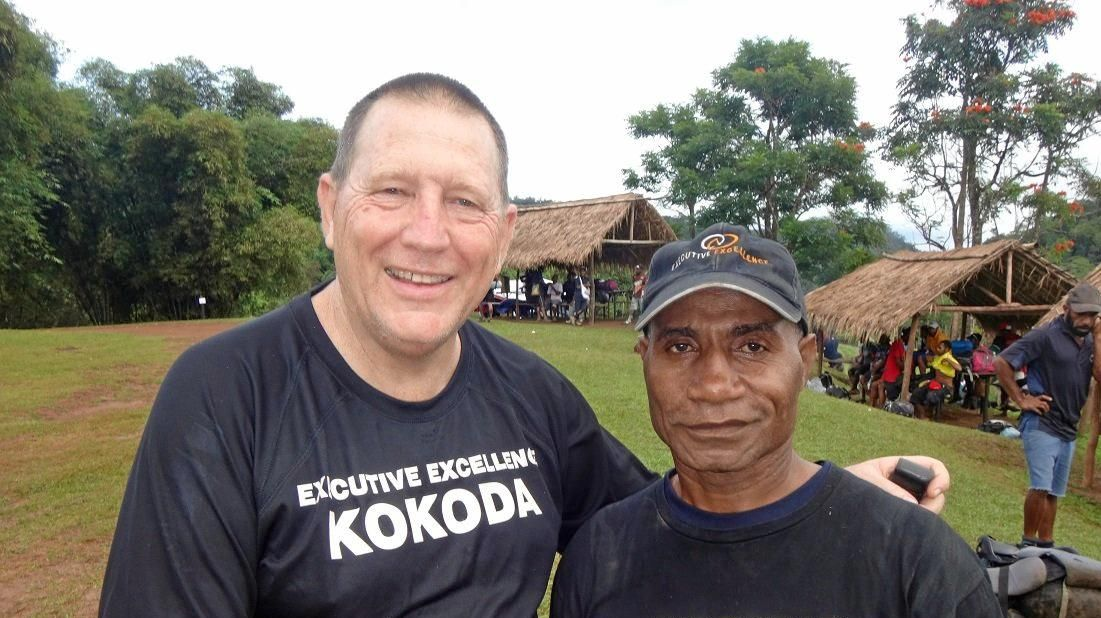 Neil Hancock on the Kokoda Trail with his guide.