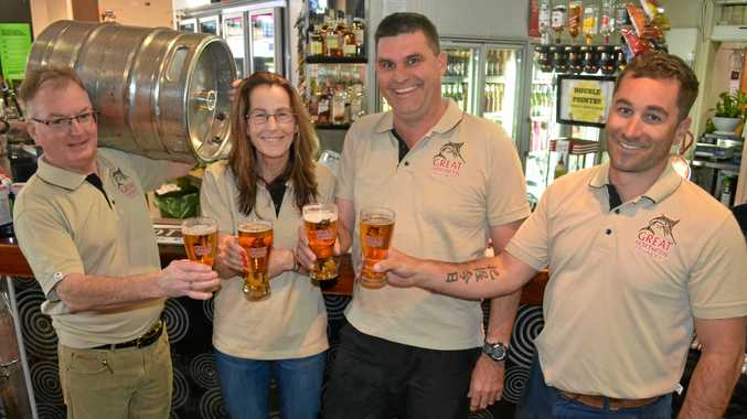 CHEERS: Ian Tyack, from the Cattle Camp in Charleville, Maureen Chalk, from the Queens Arms, Chris van'tHof, from The Club, and Michael Pike, from Carlton and United Brewery.