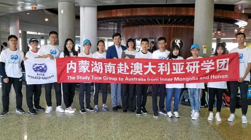 DELEGATION: Students arrive at the airport.