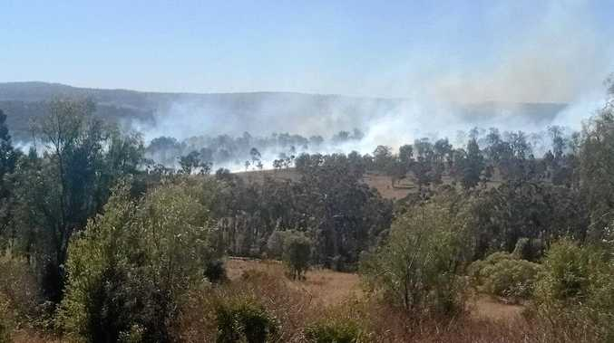 SMOKE HAZE: Large volumes of smoke are expected in the Cooyar region where a vegetation fire, sparked by arcing power lines, is expected to burn for several days.