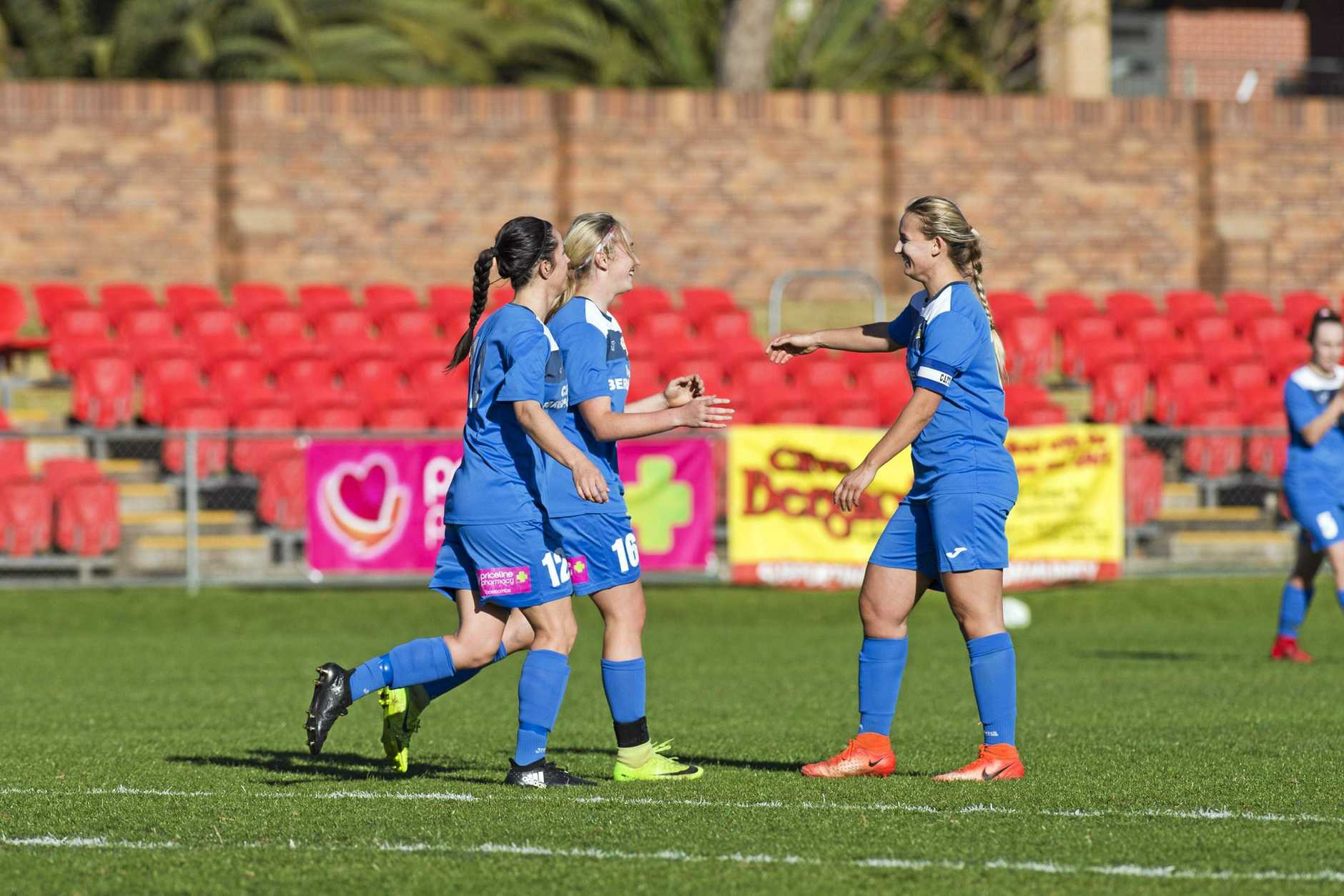 GOOD STRIKE: South West Queensland Thunder women's team players celebrate a goal against Mudgeeraba.
