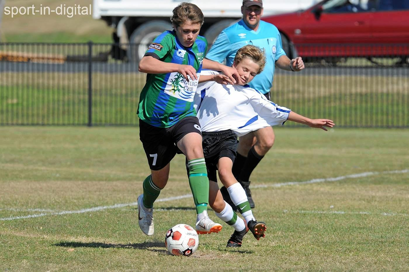 The Bobcats and Tigers fight for the ball during their 1-1 NCF Premier League draw.