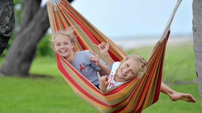 FUN: Mia and Hamish Petrov enjoy some hammock time at Town Beach, East Mackay.