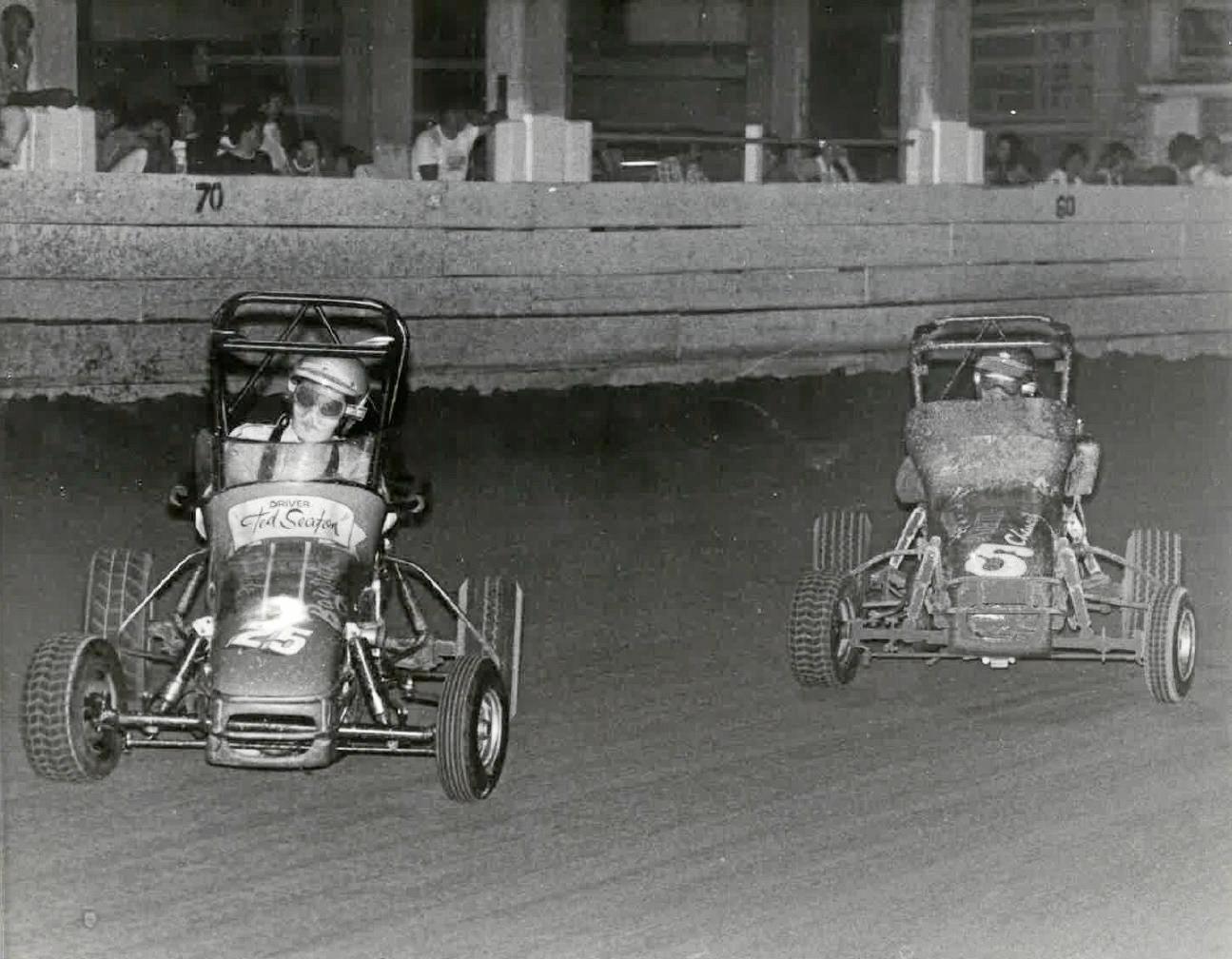 Ted Seaton, left, and John McFarlane racing their vehicles.