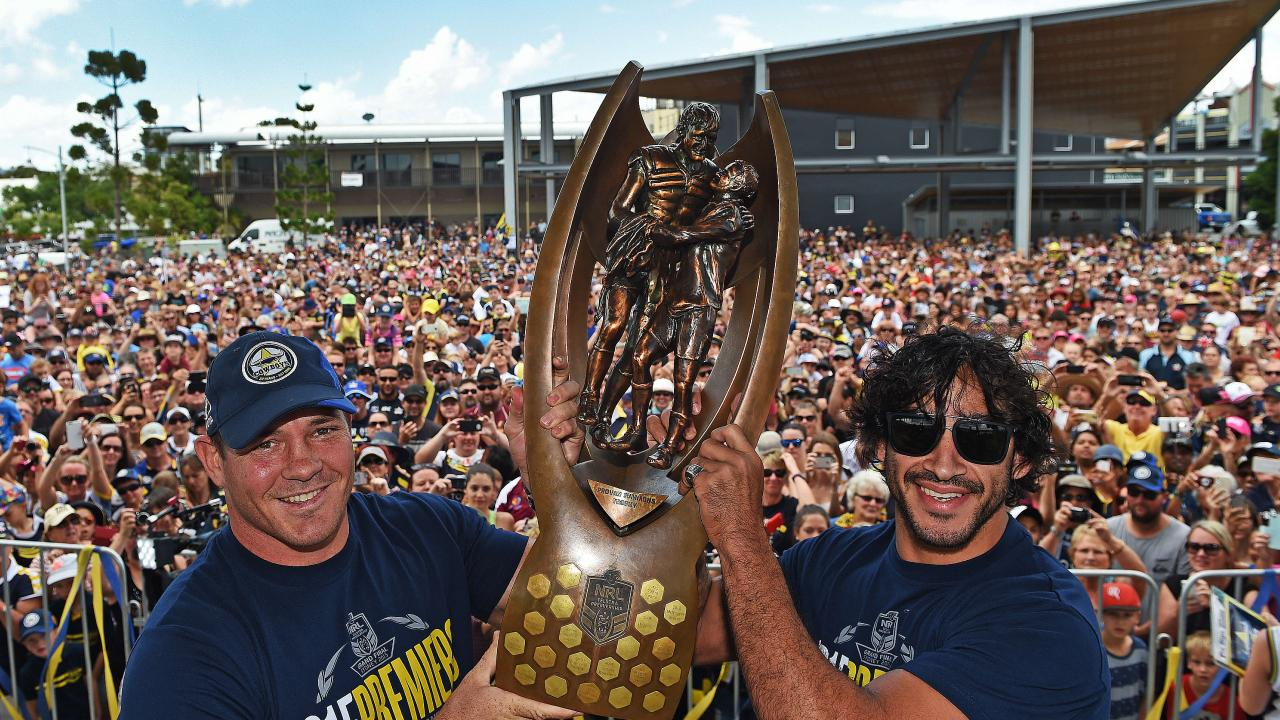 Thurston with co-captain Matt Scott after their 2015 premiership success. Picture: Zak Simmonds