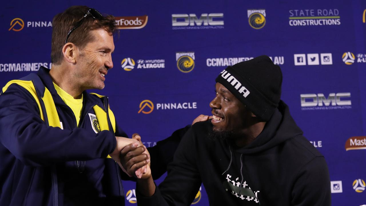 (L-R) coach Mike Mulvey welcomes Usain Bolt to the Central Coast Mariners. Picture: Brett Costello