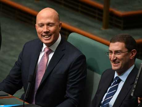 Dutton yucks it up on the backbench. Picture: AAP Image/Mick Tsikas