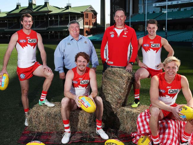 Swans Harry Cunningham, Gary Rohan, Tom Papley, Isaac Heeney, along with coach John Longmire, pose with co-founder of Buy A Bale Charles Alder. Picture. Phil Hillyard