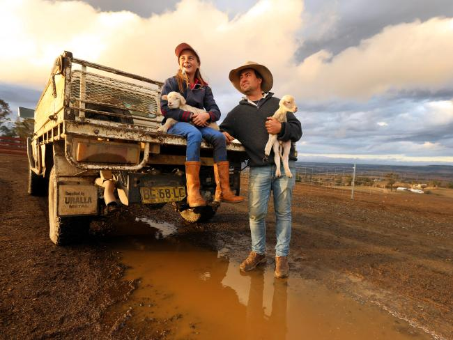 Farmer Jock McLaren with his 11-year-old daughter Mimi welcomed rain on their drought stricken property between Walcha and Tamworth earlier this month. Picture: Nathan Edwards