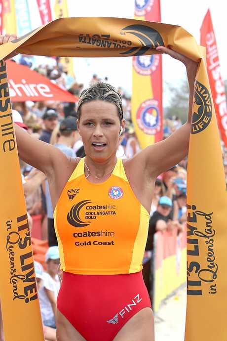 Courtney Hancock crosses the finish line to win a gruelling Coolangatta Gold for the third time.