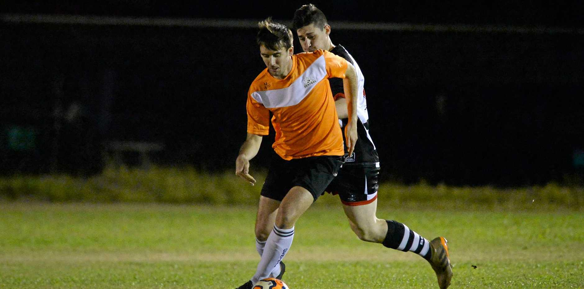 Strong Finish: Central FC player David Upton in and earlier game against Nerimbera.