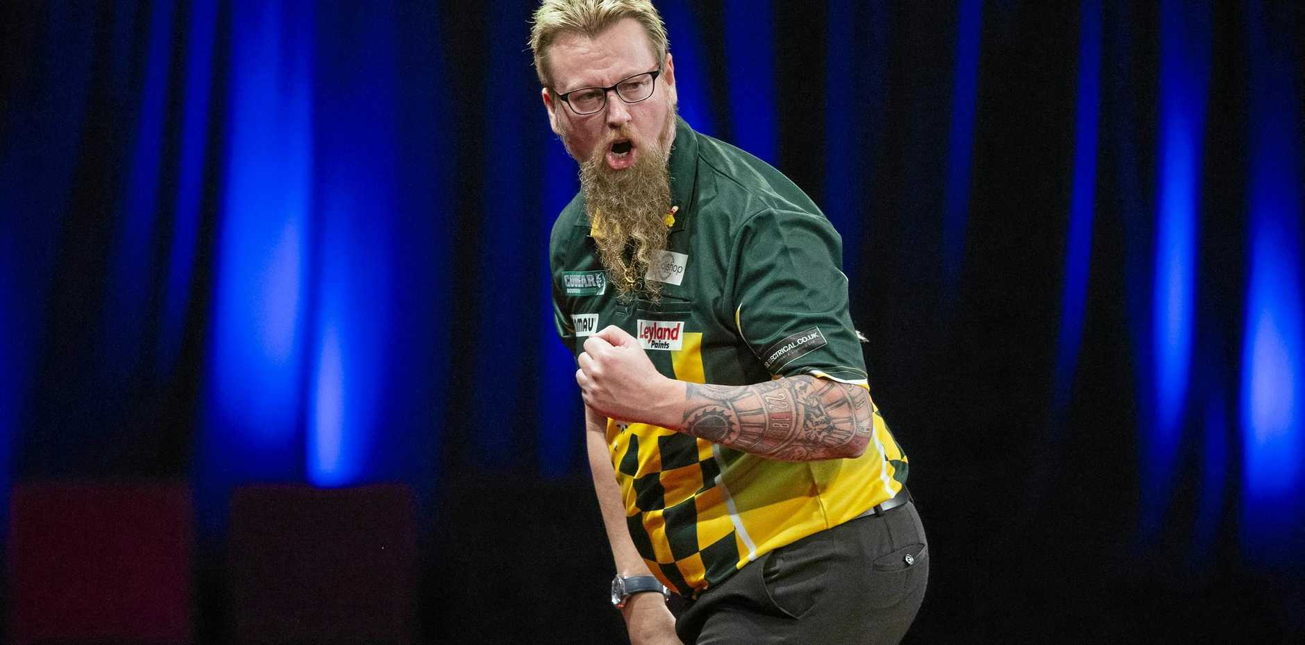 Simon Whitlock celebrates a win during the Brisbane Darts Masters.