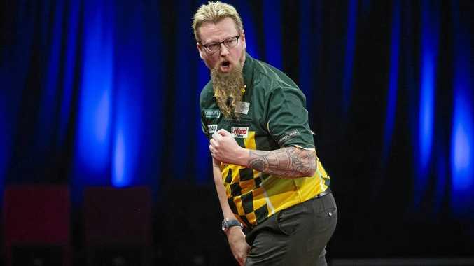 Simon Whitlock celebrates a win during the Brisbane Darts Masters.