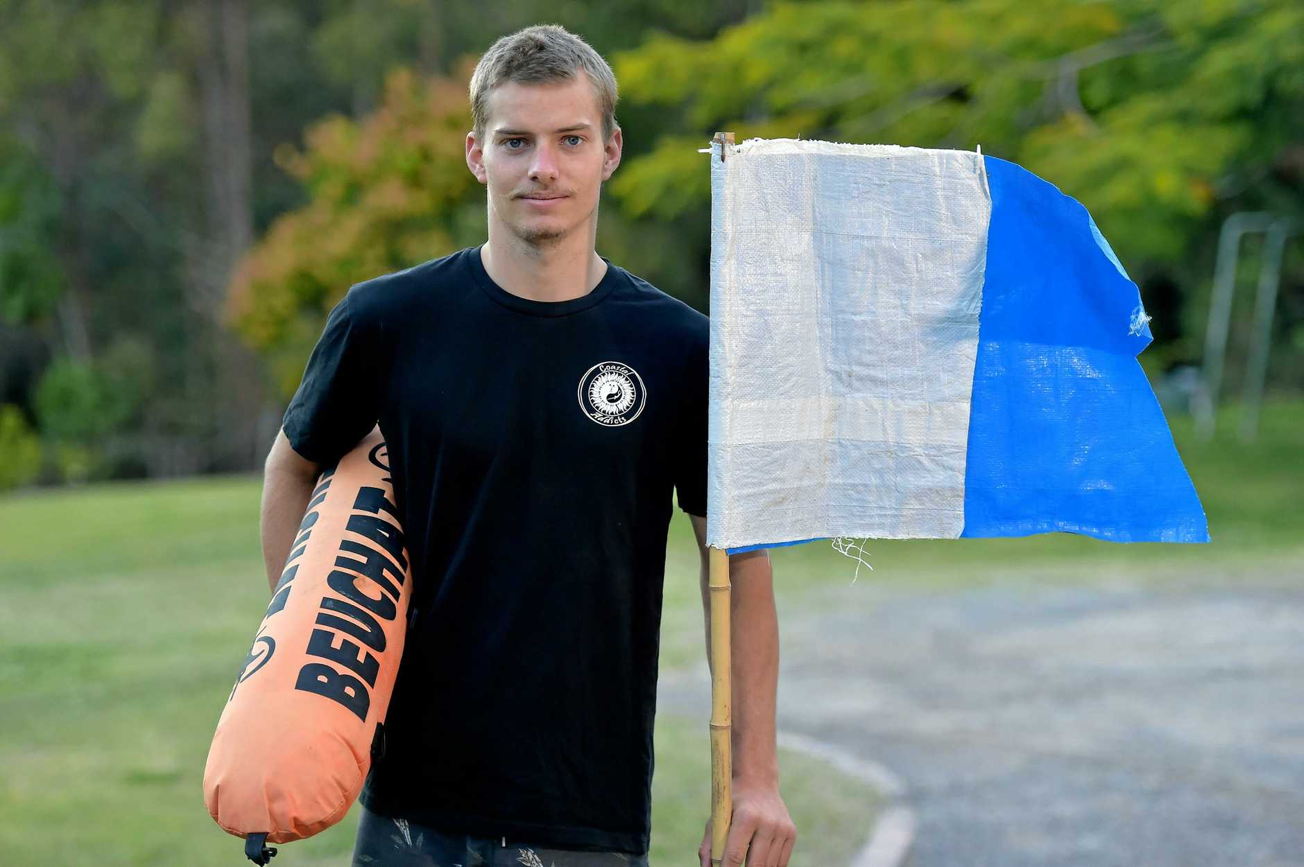 SPREAD THE WORD: Harry Rahn, 21, was hit by a jet ski while diving at Old Woman Island and is warning other water users to be careful. He is pictured with the diving flag he always displays.