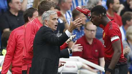Jose Mourinho speaks to Paul Pogba during Utd's 3-2 loss to Brighton and Hove Albion.