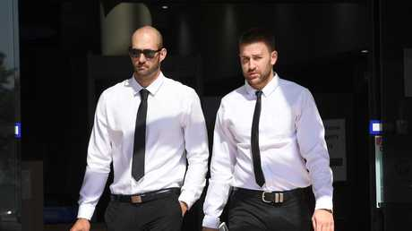 Josh Milani (left) and Sam Wallace leave the Southport courthouse in Southport on the Gold Coast, Tuesday, August 21, 2018. (AAP Image/Dave Hunt)