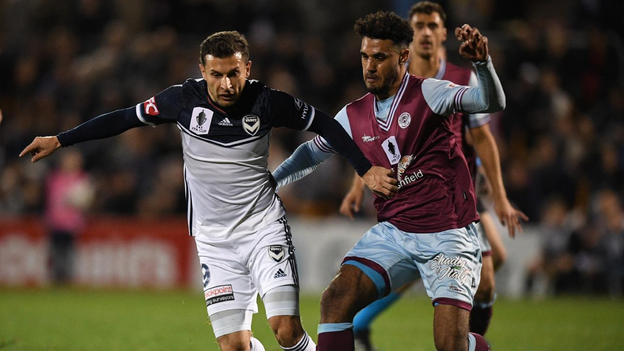 Kosta Barbarouses comes in for some close attention from the APIA defence.
