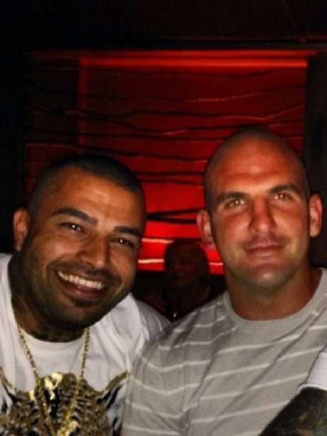 Comanchero national president Mark Buddle (right) with fellow member Ali Bazzi.