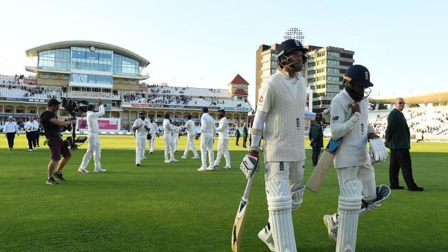 England's James Anderson and England's Adil Rashid