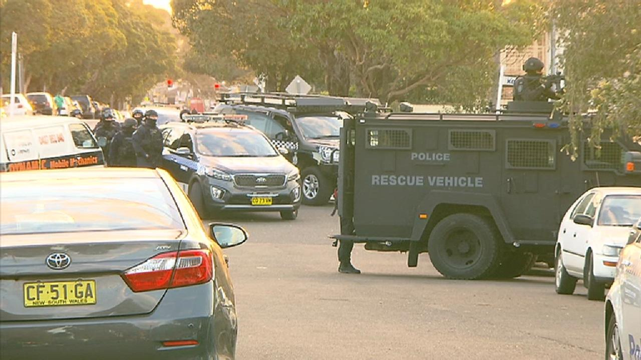 A police operation is under way on a residential street in Sydney's southwest. Photo credit: Rob Quee