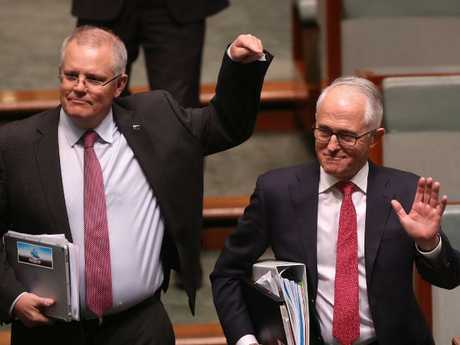 Mr Turnbull, pictured with Scott Morrison, won the vote 48-35, but many believe that's too narrow a margin to save him. Picture Kym Smith