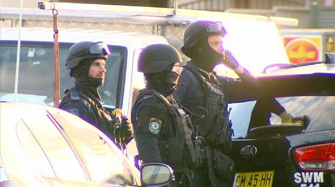 A number of heavily armed Tactical Operations Unit officers have swarmed a Western Sydney suburb, following reports of a man's assault this afternoon. Photo credit: Rob Quee.