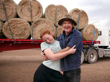 Lillie Jones with her dad Les after hay bales were trucked in from Victoria after members of the public donated to The Daily Telegraph and Sunday Telegraph's drought appeal. Picture: Sam Ruttyn