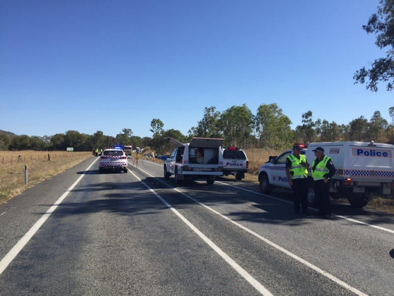 Police at the scene of a fatal crash on the Bruce Highway south of Bloomsbury