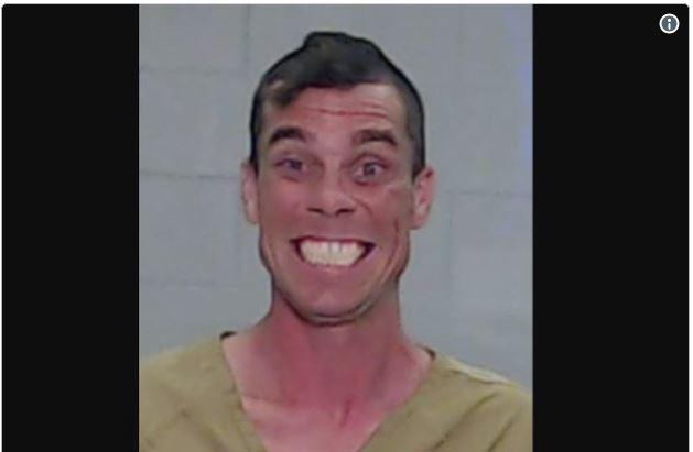 Grinning criminal's mug-shot goes viral.