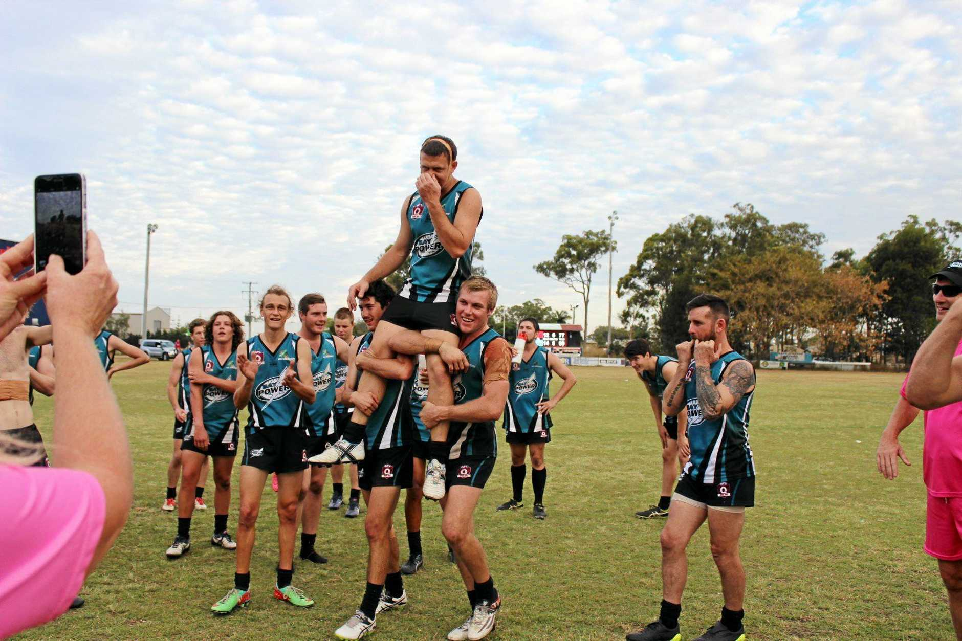 PRIDE: Bay Power player Benny Driscoll, pictured celebrating his 100th senior game last year and (inset) as captain in 2013, has lived the rise of the Power as an AFL Wide Bay force.