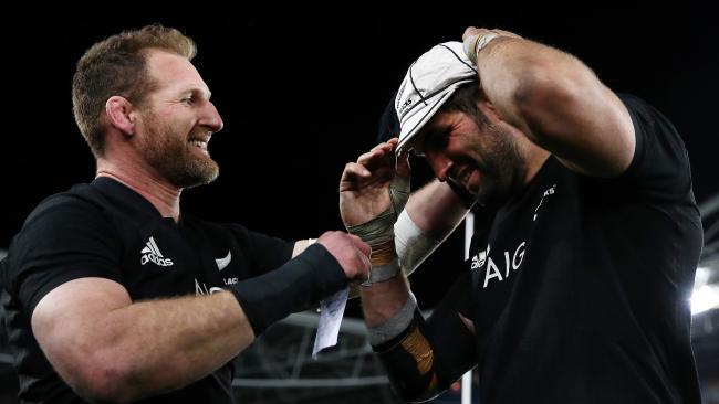 All Blacks captain Kieran Read presents Sam Whitelock with his centurions cap.