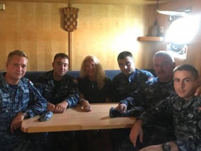 Kay Longstaff with her Croatian coast guard rescuers. Picture: MORH/ Supplied