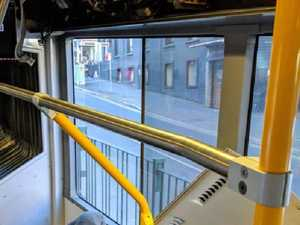 Falling bus panel narrowly misses passengers