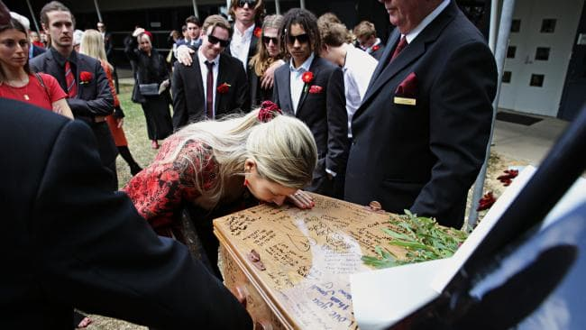 Sister Hayley says goodbye to little brother Angus Prior, 18, at his funeral at Pittwater Uniting church. Picture: Adam Yip.