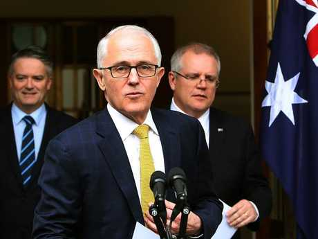 Malcolm Turnbull, pictured at a press conference with Senator Mathias Cormann and Treasurer Scott Morrison yesterday, is trying to hold on to his position as Prime Minister. Picture Kym Smith