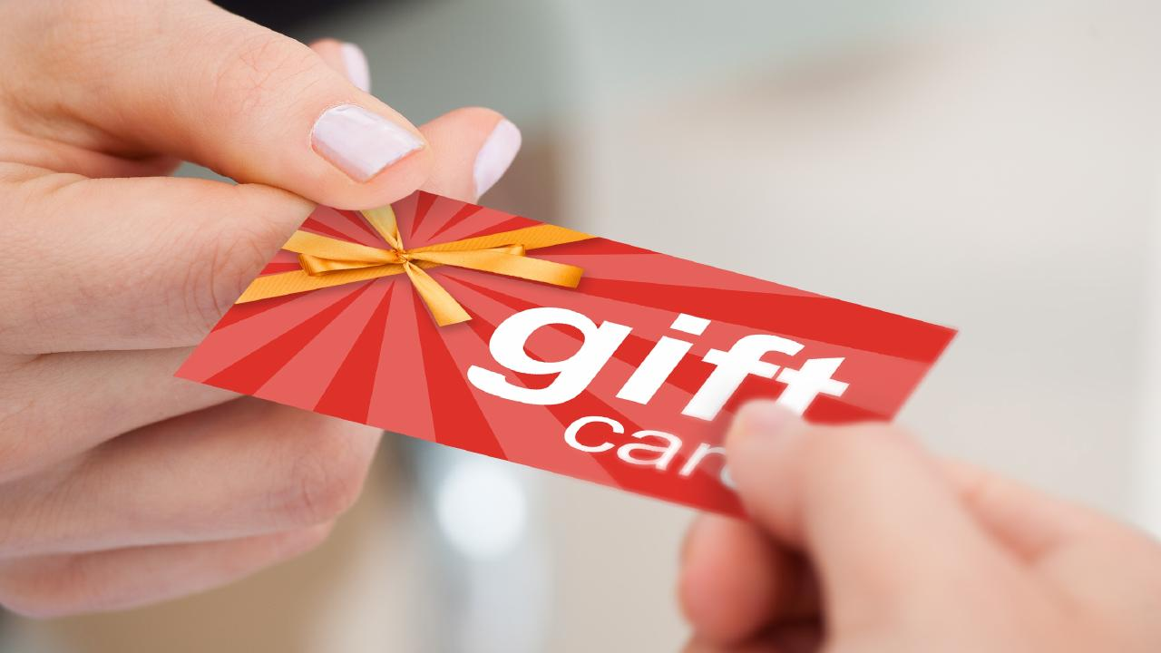 Woman using a gift card to pay. Picture: iStock.