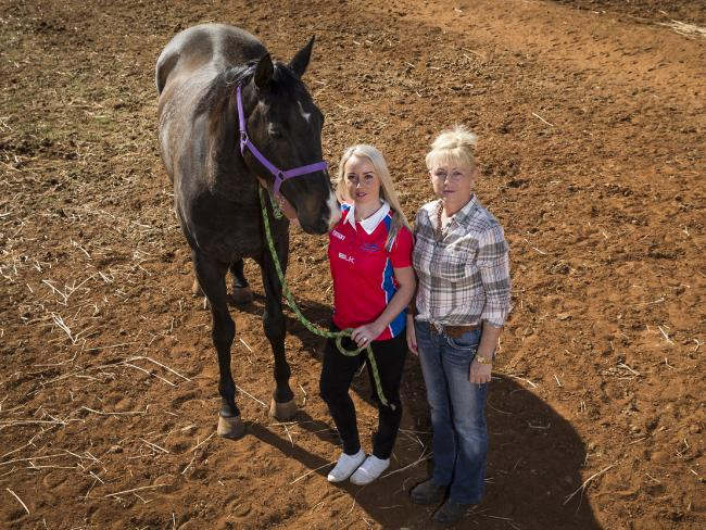 Horse trainer Sharon Jeffries, with jockey daughter Tiffany, says things will only get worst from here. Picture: Dylan Robinson