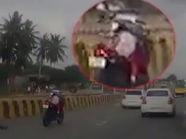The baby stayed on the bike as it continued driving and cutting lanes amid busy traffic.