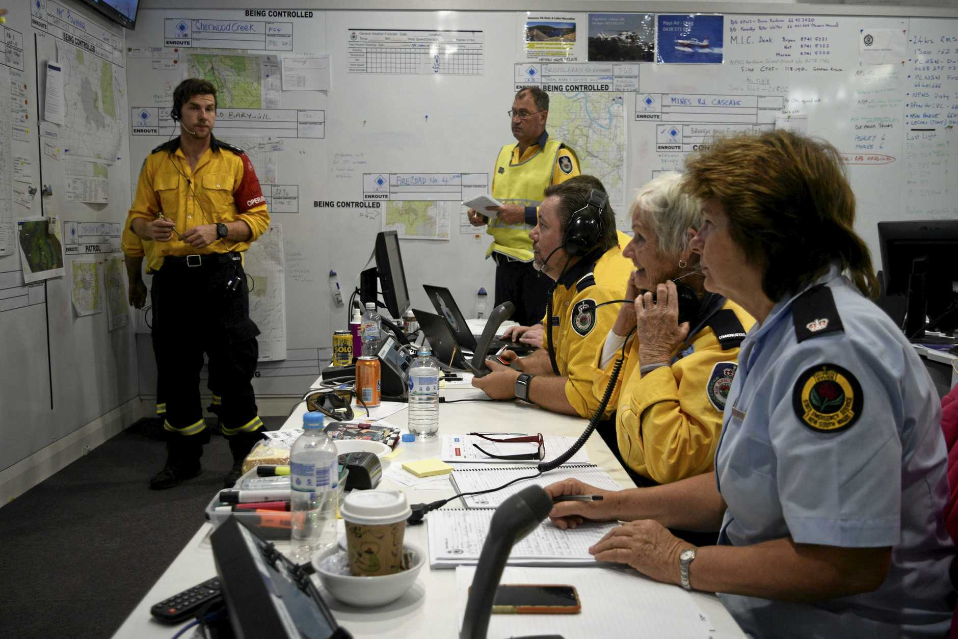 HARDWORKING: Rural Fire Service volunteers and other emergency workers at the Central Valley Fire Control Centre in Ulmarra.