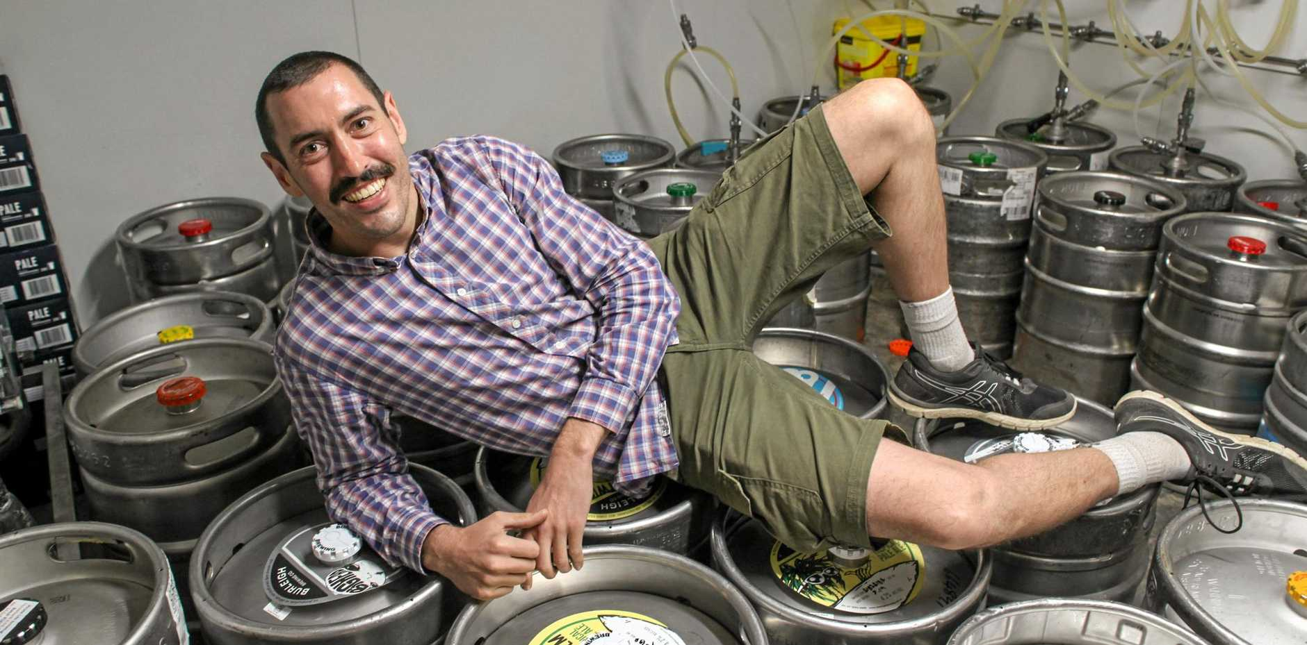 Adrian Young with stacks of kegs ready for thirsty punters headed for the inaugural Mackay Beer and BBQ Festival.