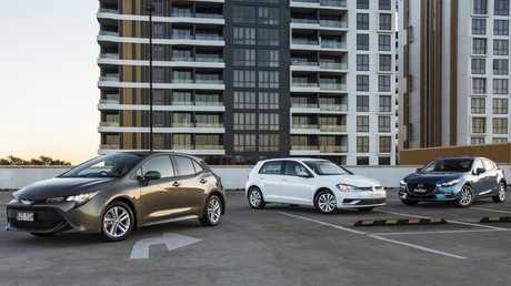 From left to right: Toyota Corolla, VW Golf and Mazda3. Picture: Mark Bean.