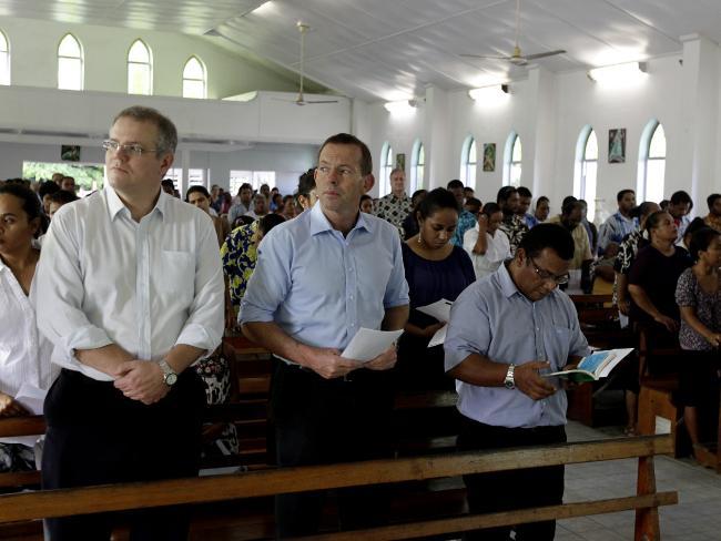 Scott Morrison attends a Sunday Morning Mass with Tony Abbott on Nauru. Picture: Brad Hunter/News Corp