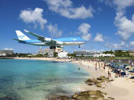 A plane begins the famous landing at Princess Juliana International Airport on the Caribbean island of Saint Martin.