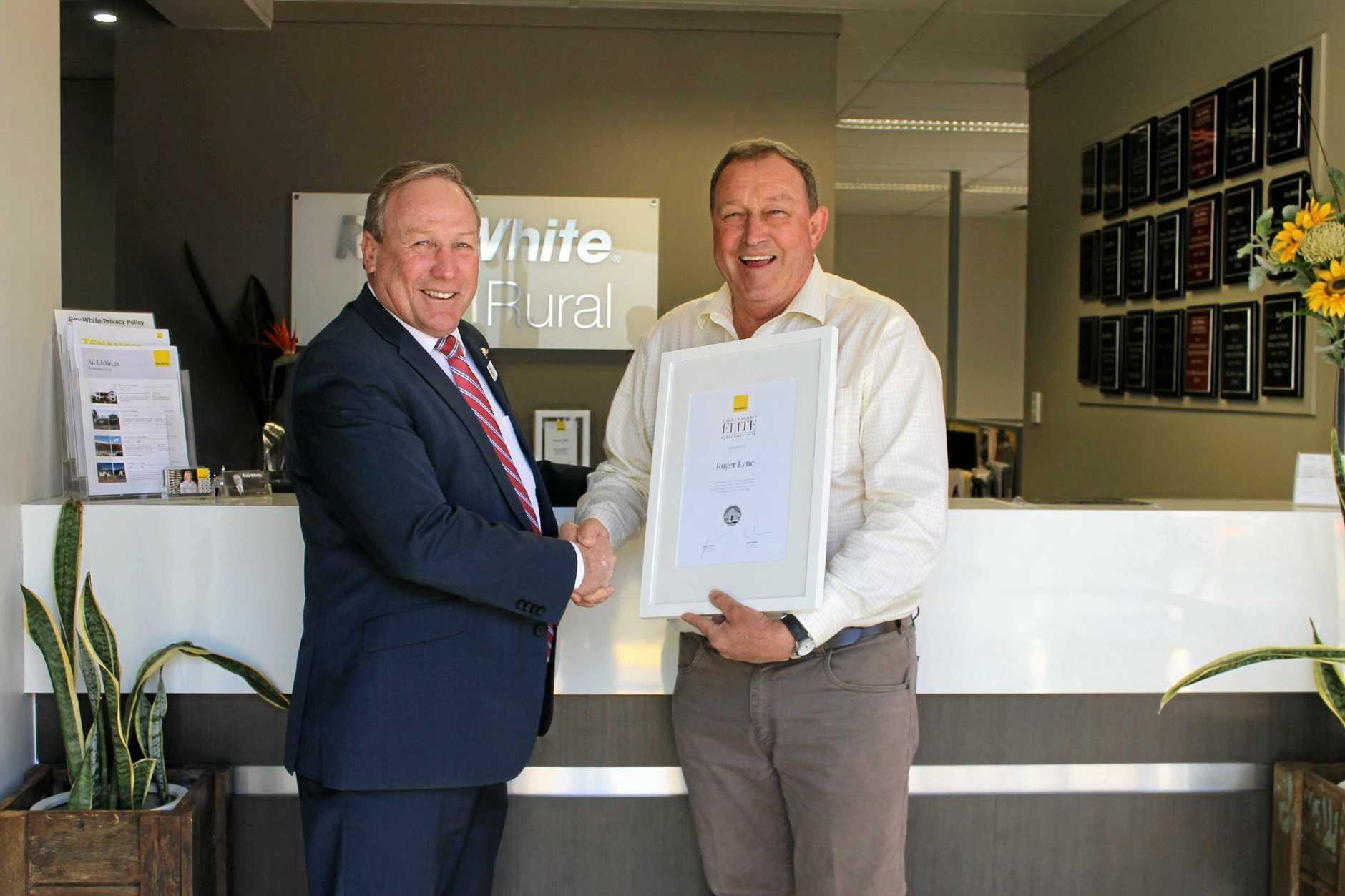 GOOD MATES: Mayor Paul McVeigh congratulates Roger Lyne his award.