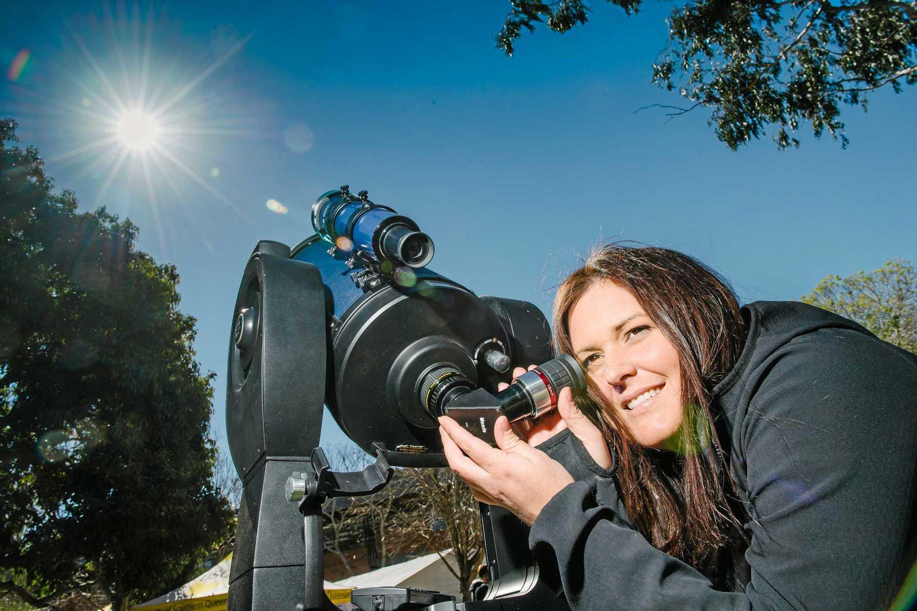Josie McFadyen solar gazing at USQ's Open Day.
