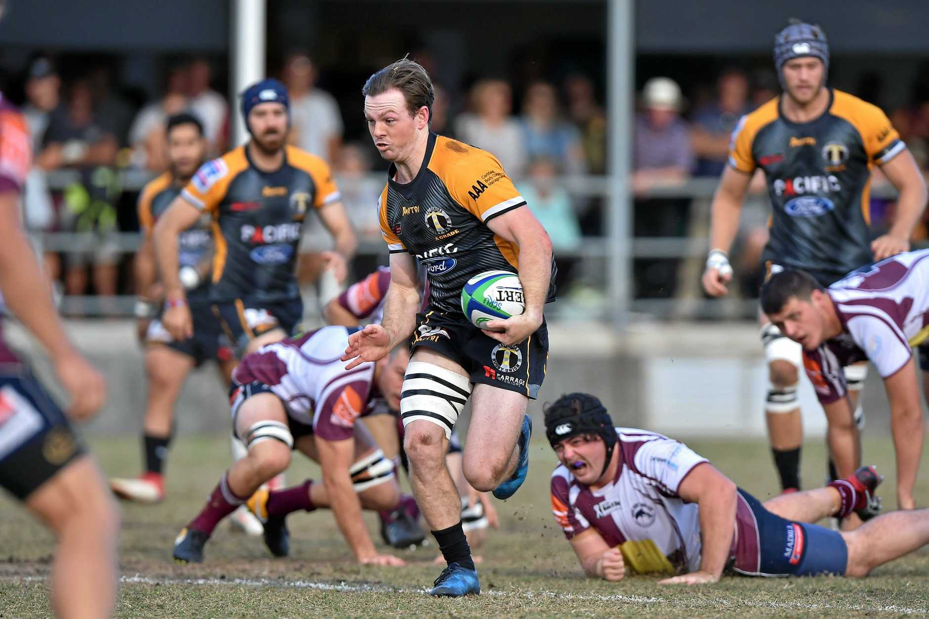 ON THE BURST: Caloundra's Mackenzie Burgess splits the defence during the grand final.