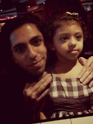 Raif Badawi, pictured with one of his children, must endure brutal lashings every week for months while serving his 10-year prison term.