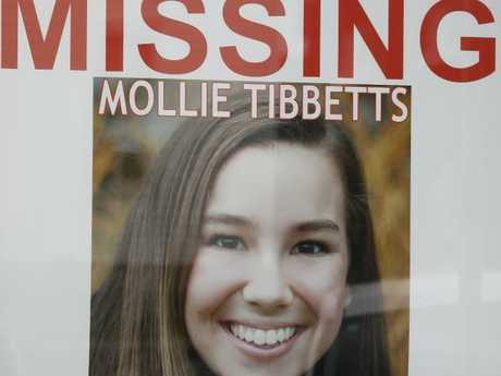 A poster for missing University of Iowa student Mollie Tibbetts hangs in the window of a local business. Picture: AP Photo/Charlie Neibergall.