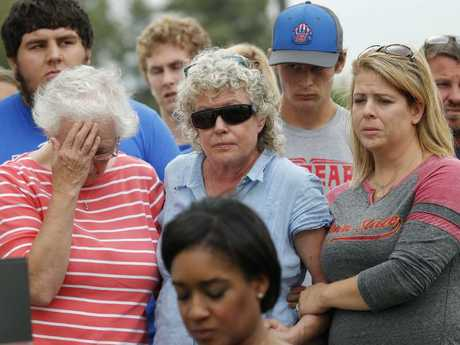 Friends and family of missing University of Iowa student Mollie Tibbetts react during a news conference. Picture: AP Photo/Charlie Neibergall.